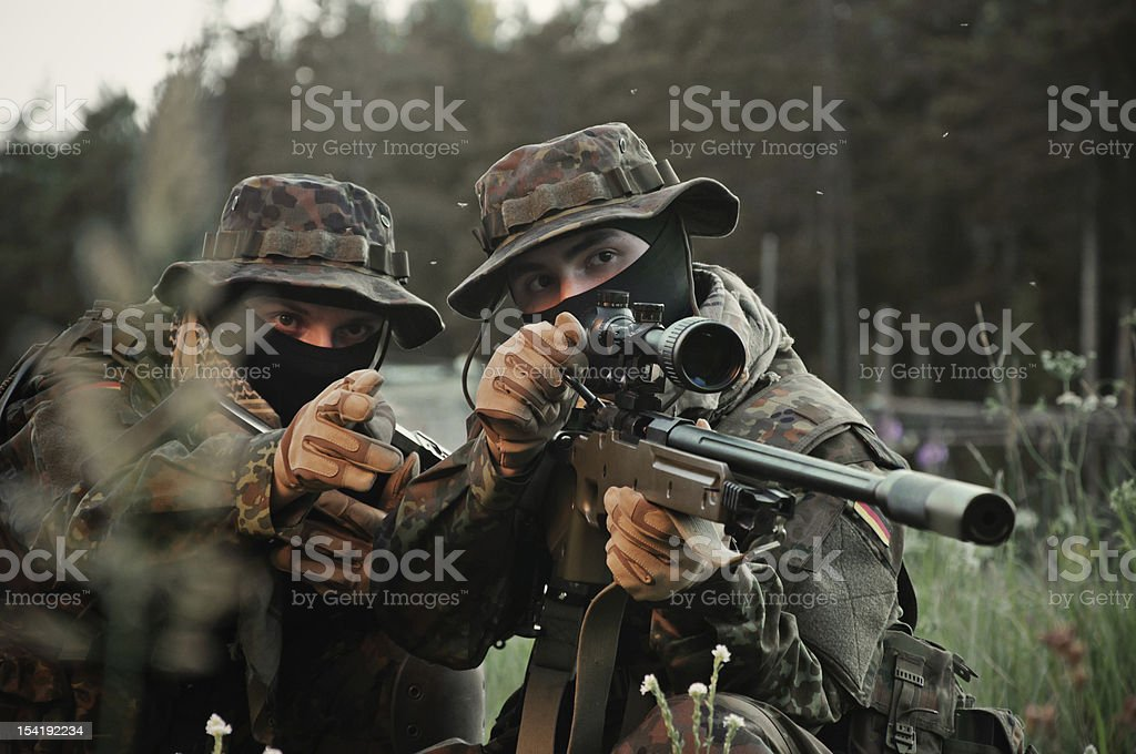Soldiers snipers attack the enemy stock photo