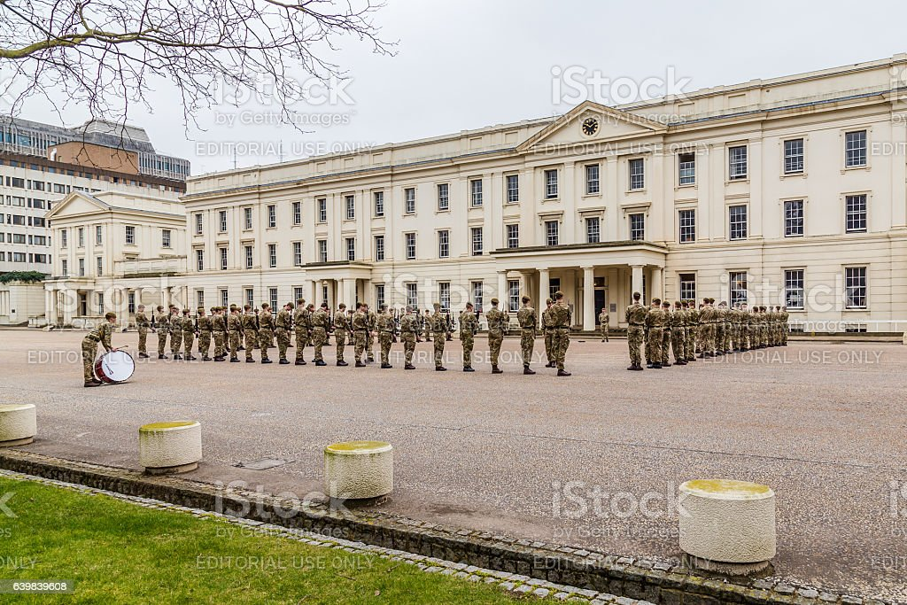 Soldiers standing to attention and being inspected outside Well stock photo