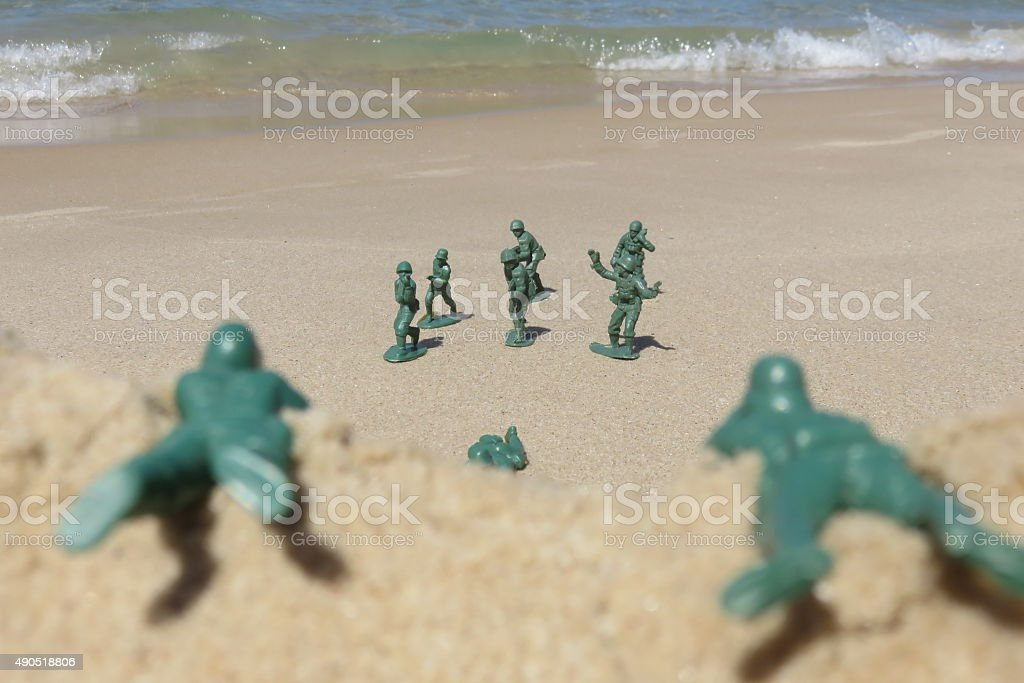 Soldiers storming the beach stock photo