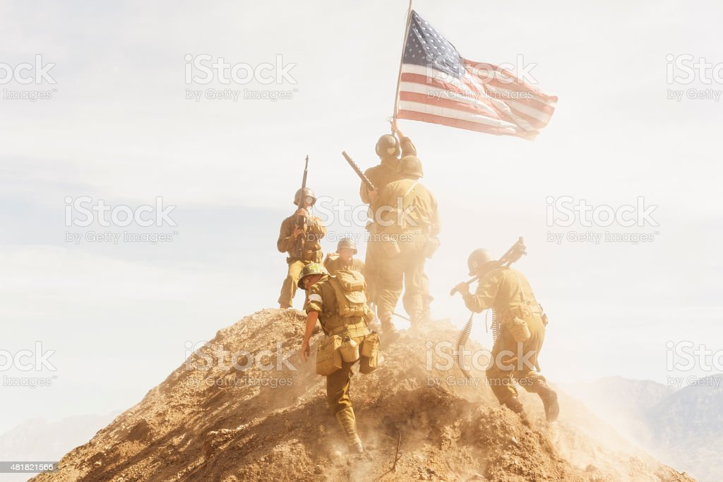Soldiers Taking a Hill During World War II stock photo
