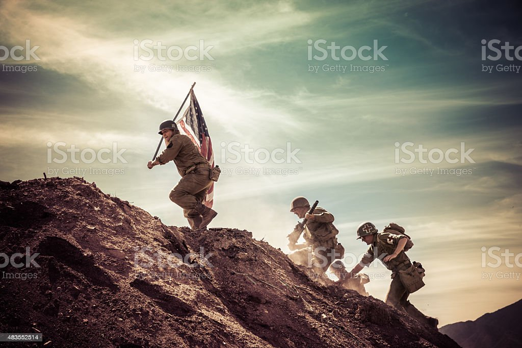 WWII Soldiers Taking a Hill stock photo