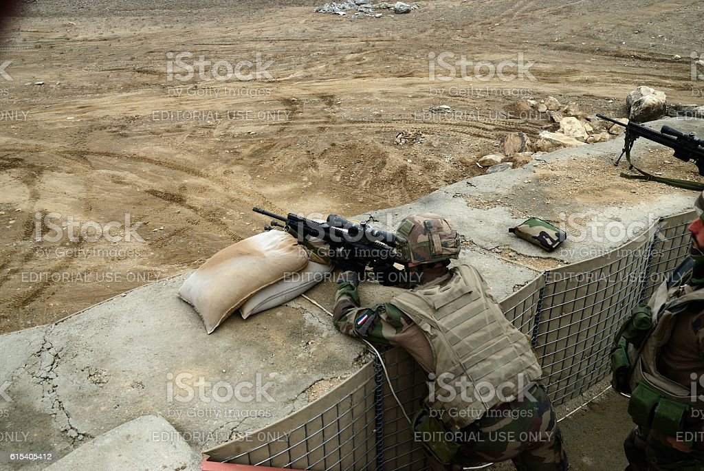 Soldiers targeting from covered position stock photo