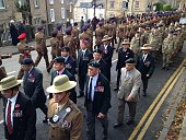 Soldiers, veterans and cadets marching