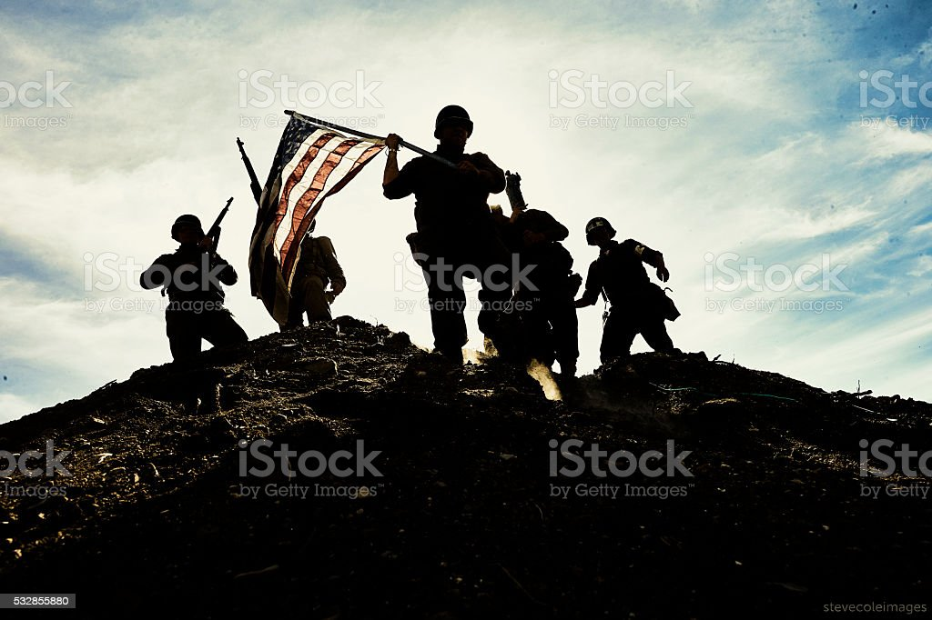 Soldiers with American flag. stock photo