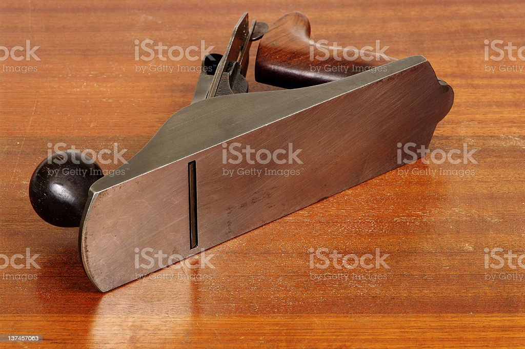 Sole Of Smoothing Plane Reflected In Polished Bench royalty-free stock photo