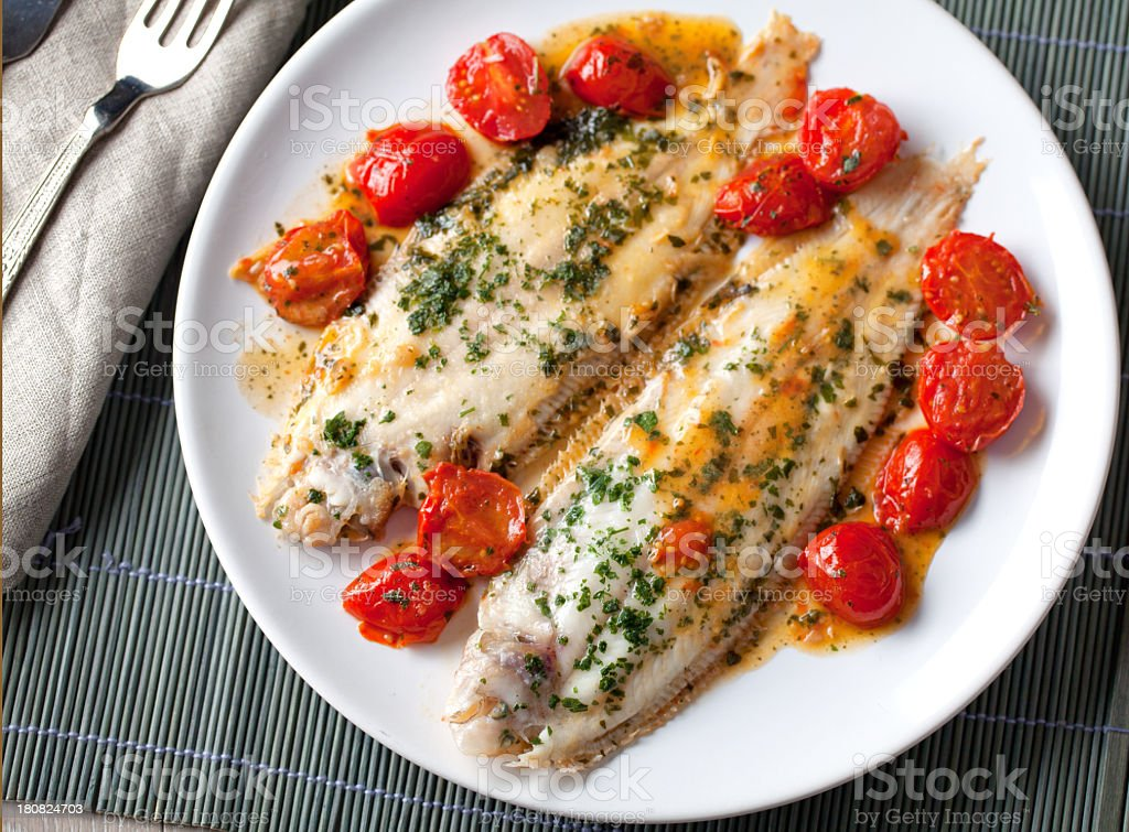 Sole with cherry tomatoes stock photo