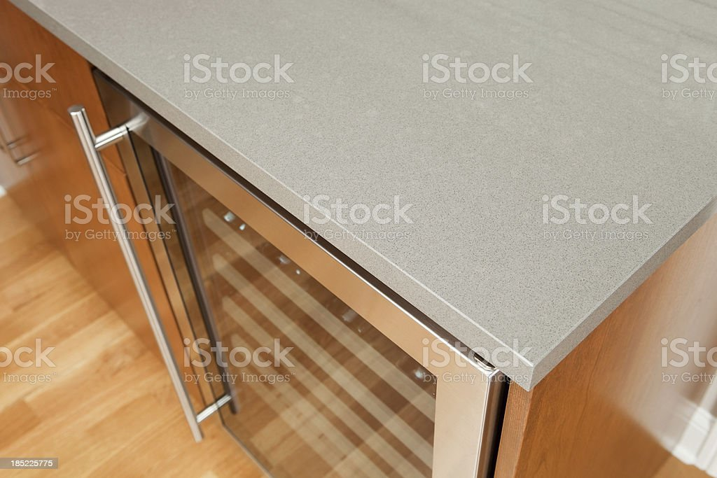 Solid Surface Kitchen Counter with Wine Cooler stock photo
