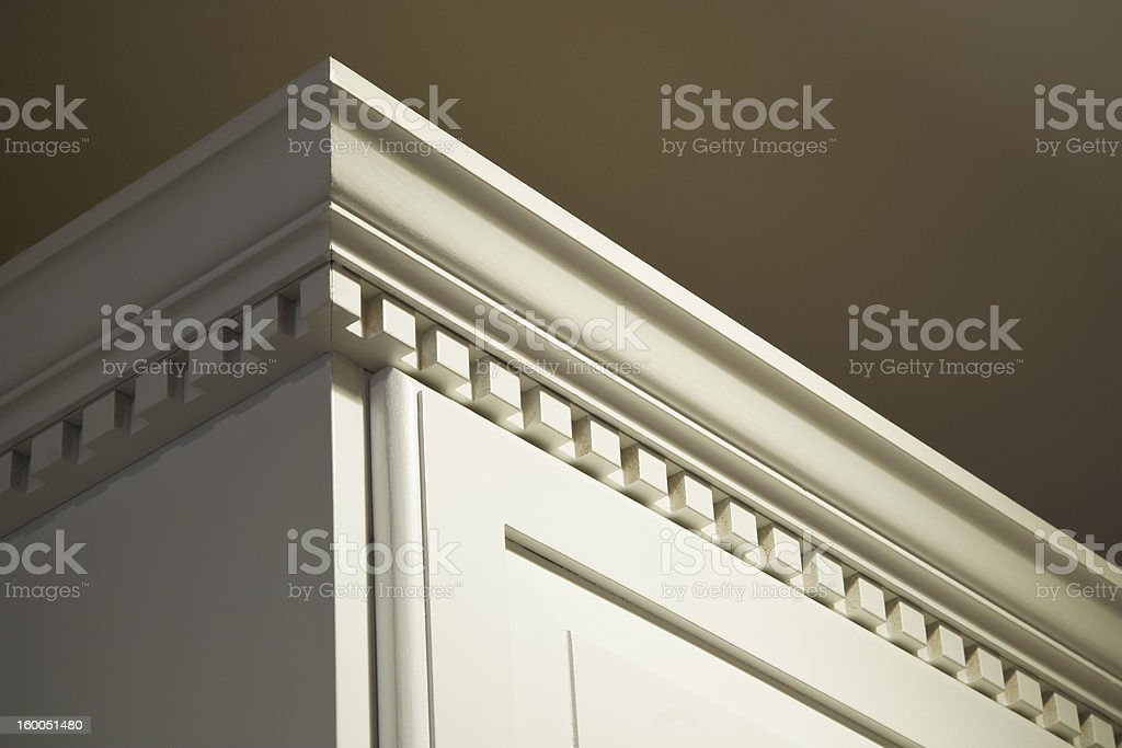 Solid Wood Kitchen Cabinet Crown Moulding Dentil Detail stock photo