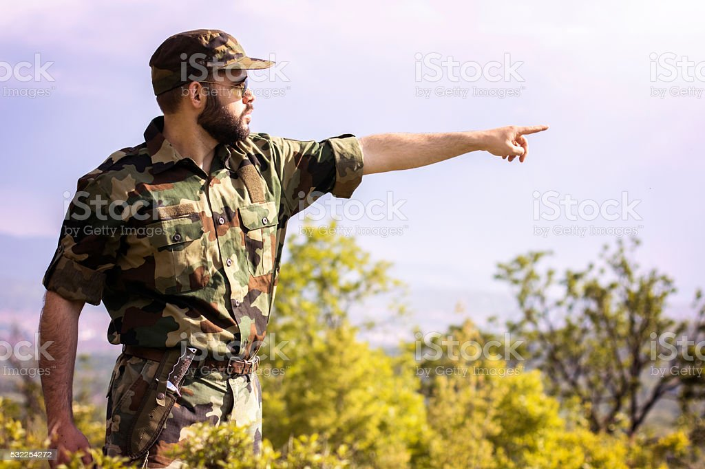 Solider in uniform showing the path stock photo