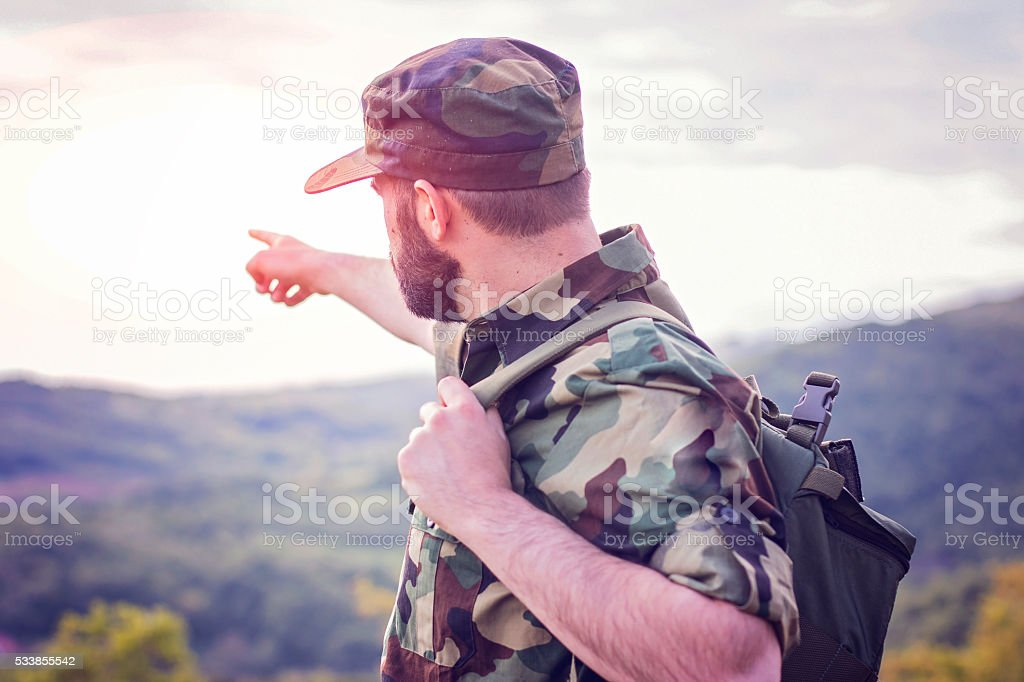 Solider showing directions stock photo