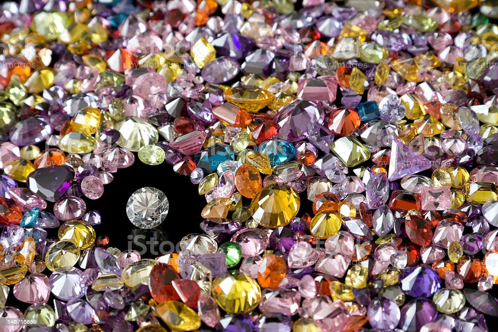 Solitaire Diamond Surrounded By Colorful Gems royalty-free stock photo