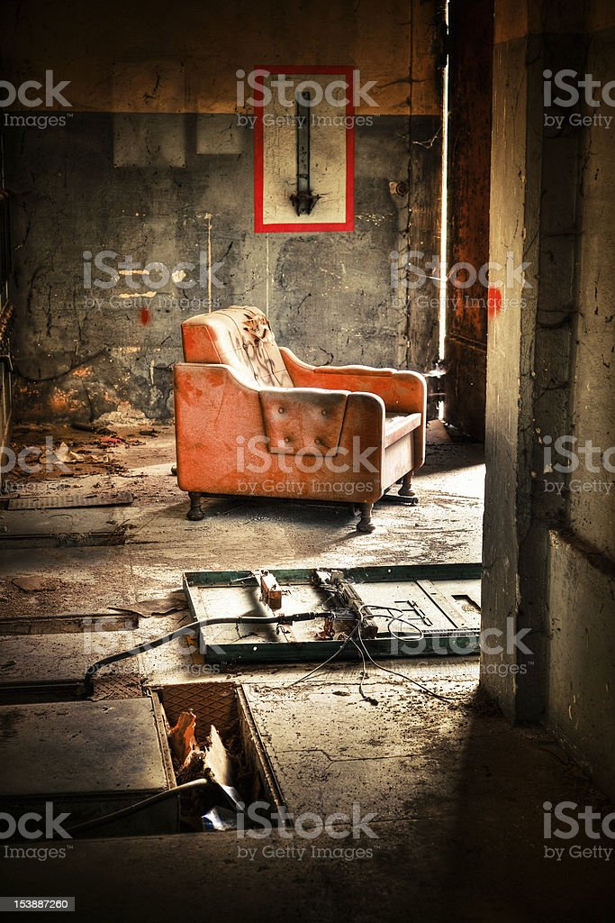 Solitary Armchair in Ruined Rotten Building royalty-free stock photo