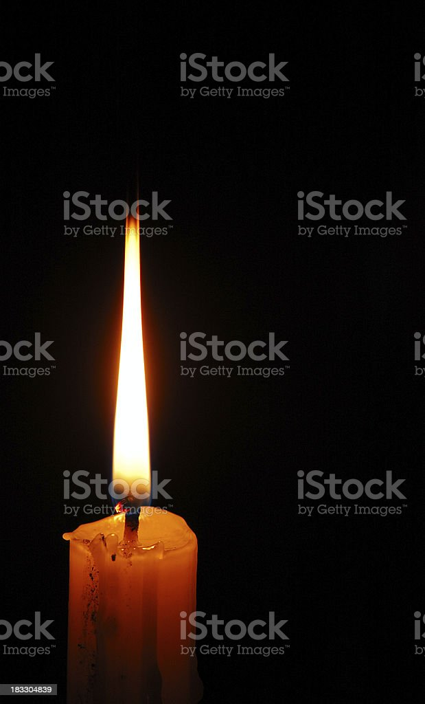 Solitary Candle Burning royalty-free stock photo