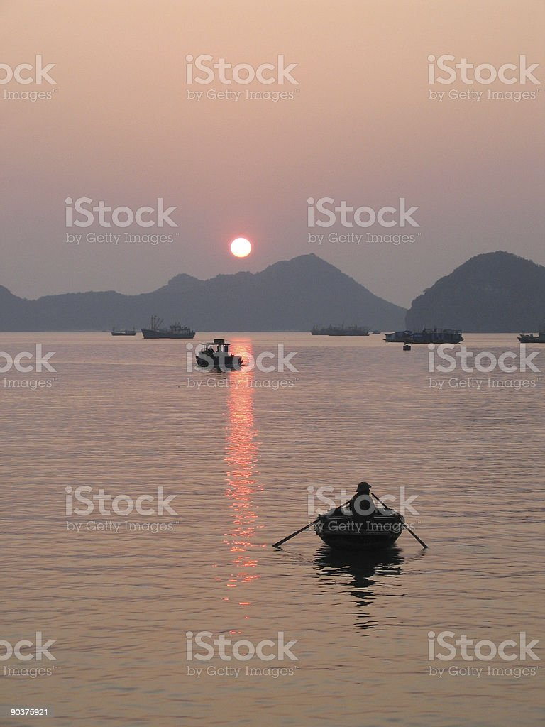 Solitary Fisherman Rowing to the Open Sea royalty-free stock photo