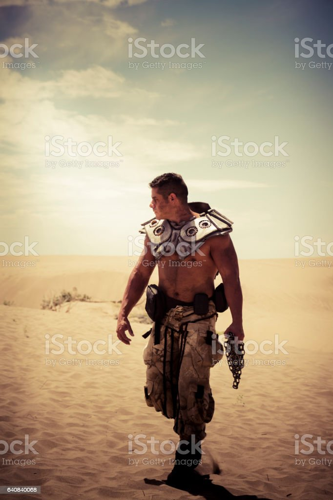 Solitary Futuristic Soldier Walks Through The Desert stock photo