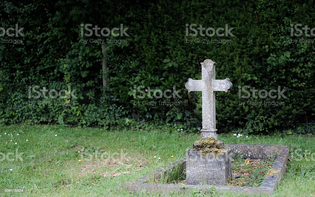Solitary gravestone in a typical cemetery stock photo