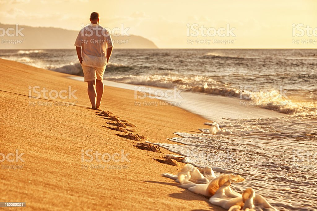 Solitary Man Walking on Hawaiian Beach royalty-free stock photo