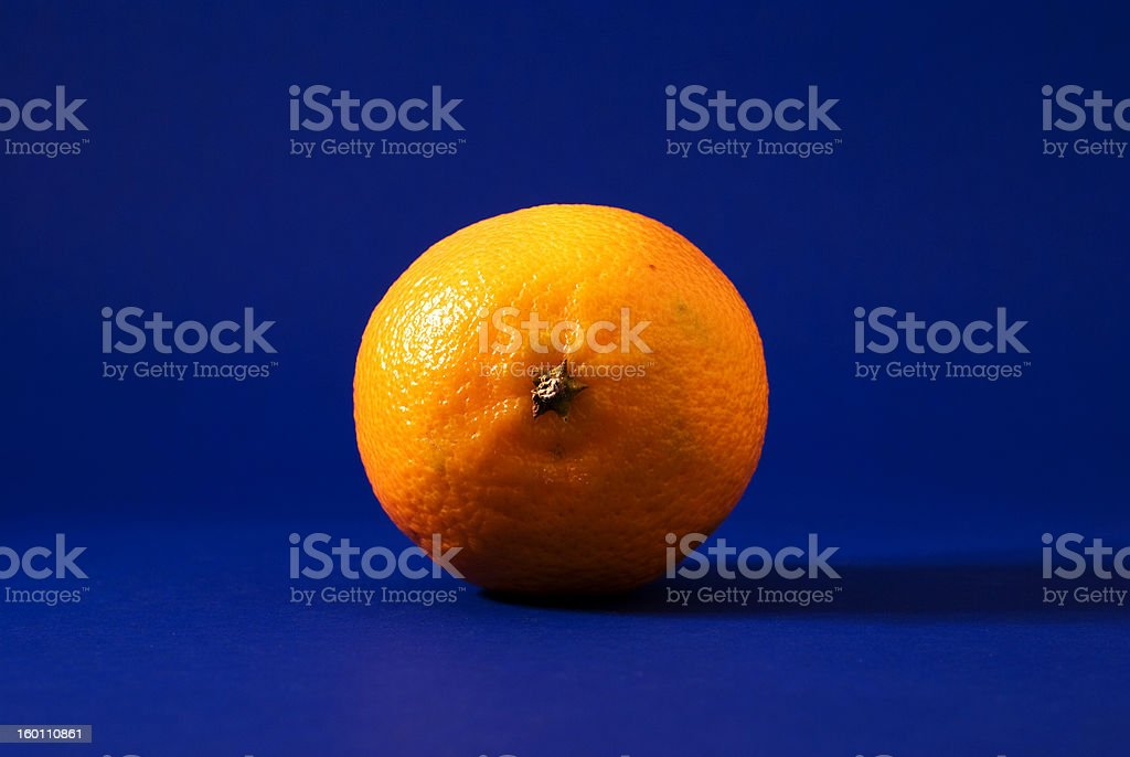 Solitary Mandarin Orange on Blue Seamless Background royalty-free stock photo