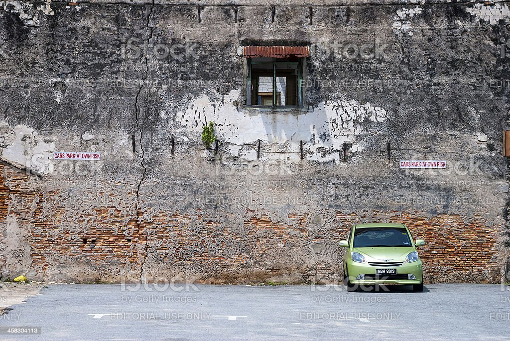 Solitary parked car in Malaysia royalty-free stock photo