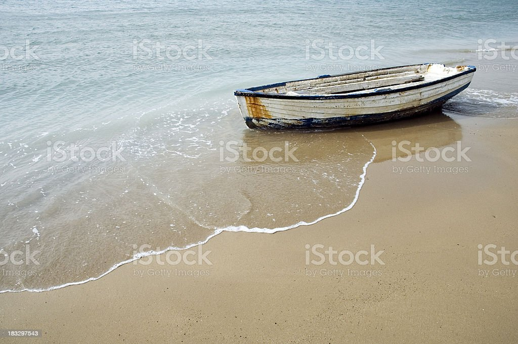 Solitary Rowing Boat on a Sandy Beach stock photo