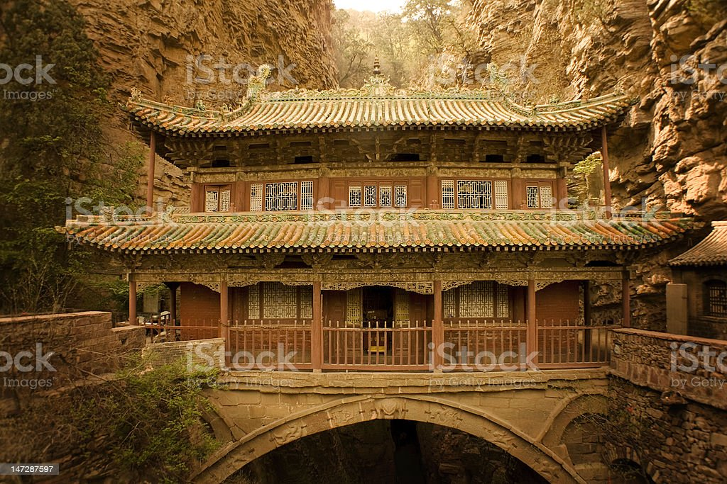 solitary temple over a deep canyon in China stock photo