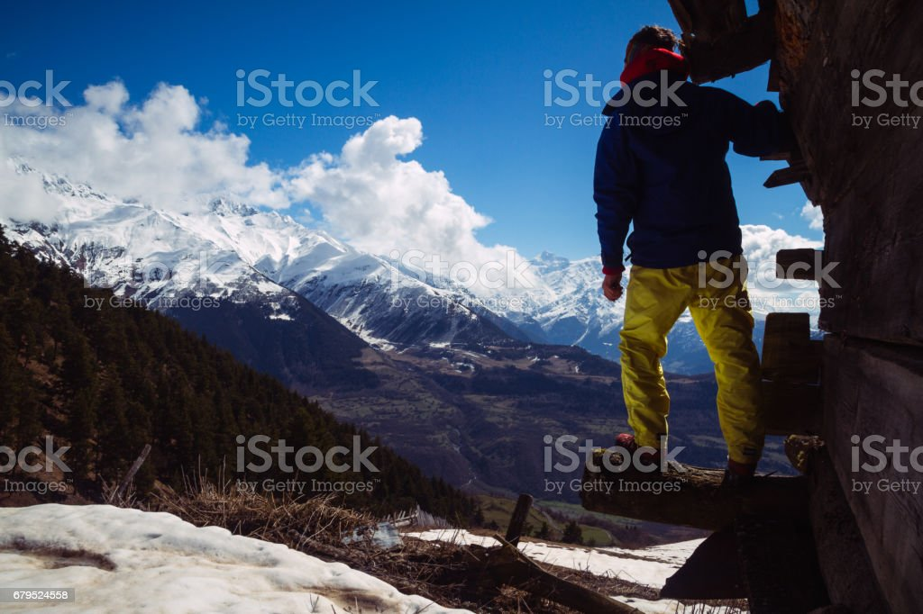 Solitary traveler is looking at the caucasian mountains stock photo