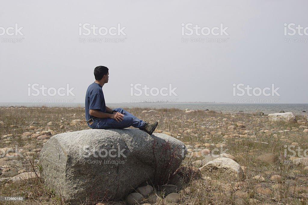 Solitude - Hiker Sitting on Rock stock photo