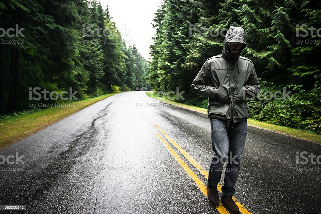 Solitude man walking on the street in British columbia stock photo
