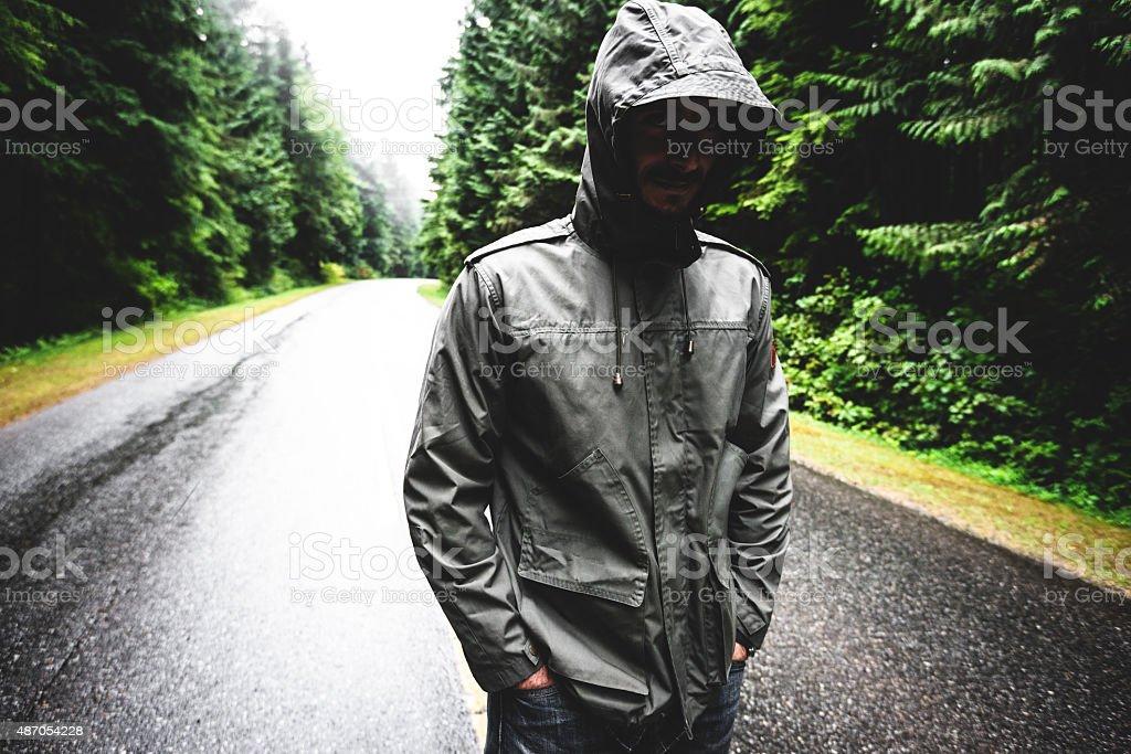Solitude man walking on the street stock photo