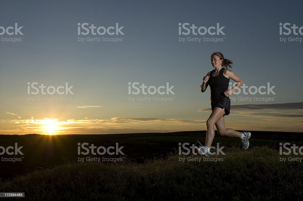 Solo Female Runner at Sunset royalty-free stock photo
