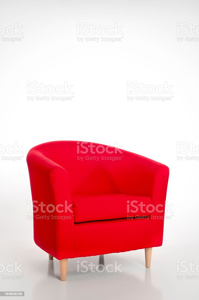 Solo red armchair on white background stock photo