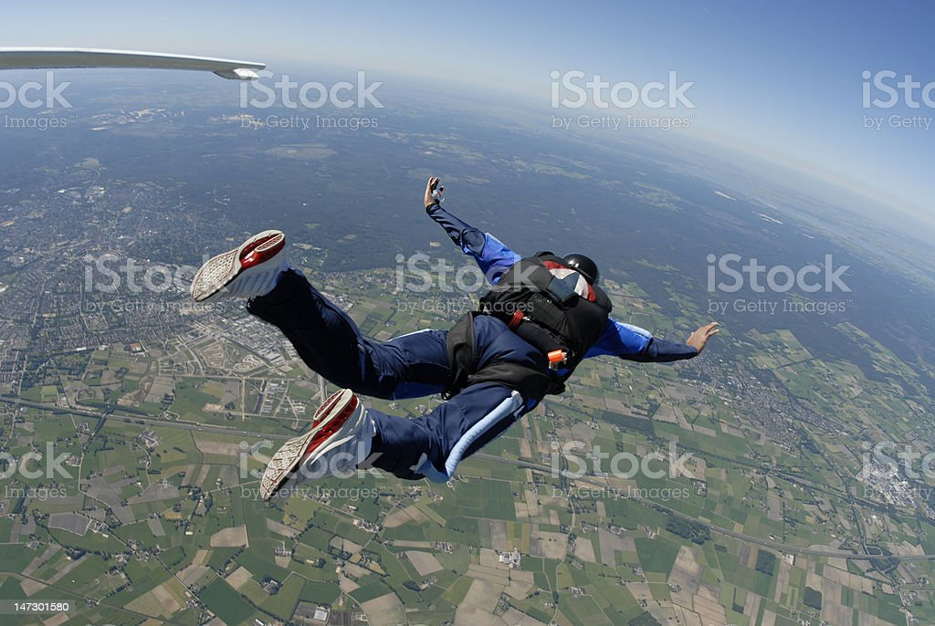 solo skydiver diving out stock photo