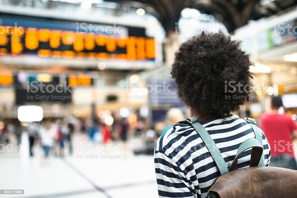 solo traveler in london liverpool street station stock photo