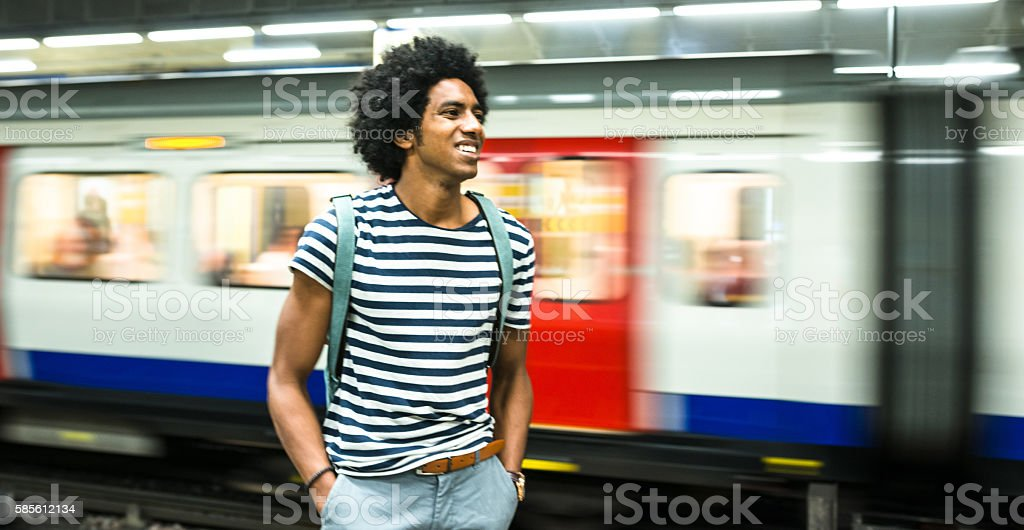 solo traveler on a london station stock photo
