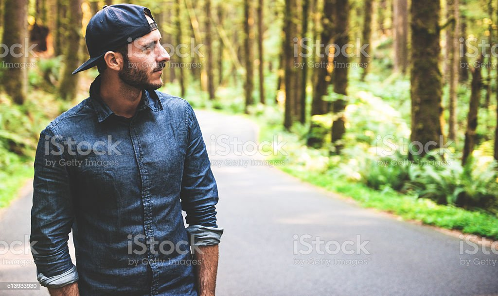 Solo traveler walking in the park - oregon stock photo