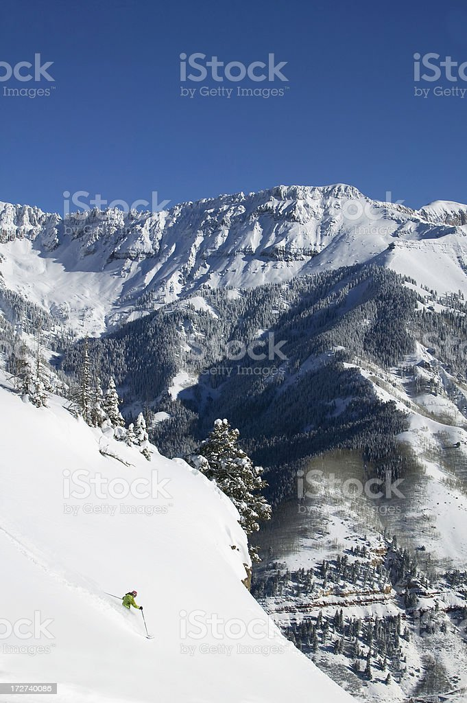 Solo woman skier with mountains in Background stock photo