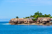 Solomon Islands Beach with Traditional Thatched Houses in Auki