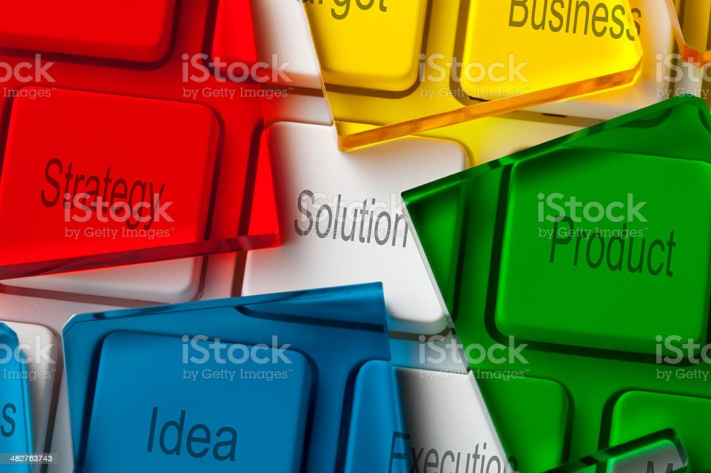 Solution. Computer keyboard with pieces of a puzzle. stock photo
