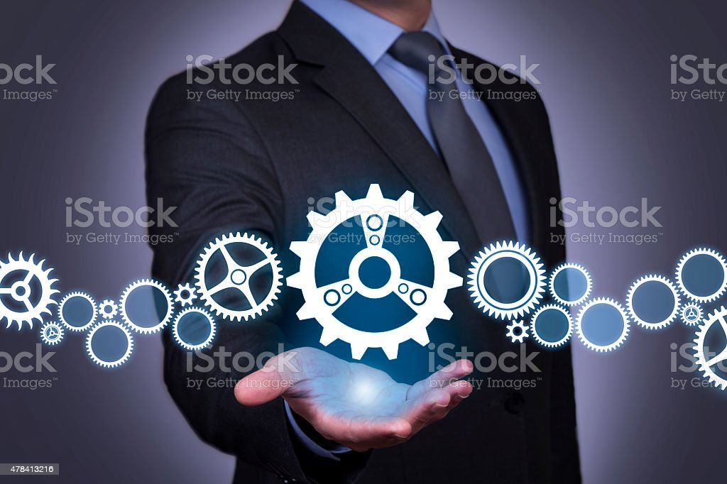 Solution Gear on Businessman Hand stock photo