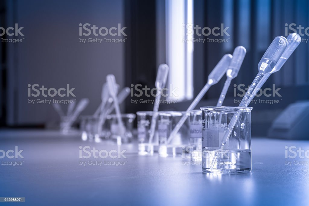 Solution in beakers with dropper, science laboratory royalty-free stock photo