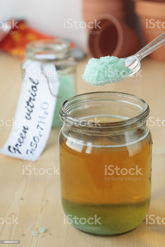 Solution of iron sulphate in jar stock photo