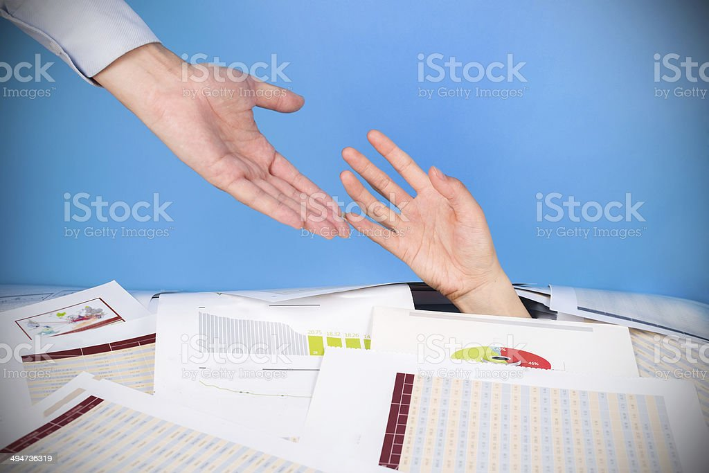 solutions for bussiness problems :hand touching in crumpled papers stock photo