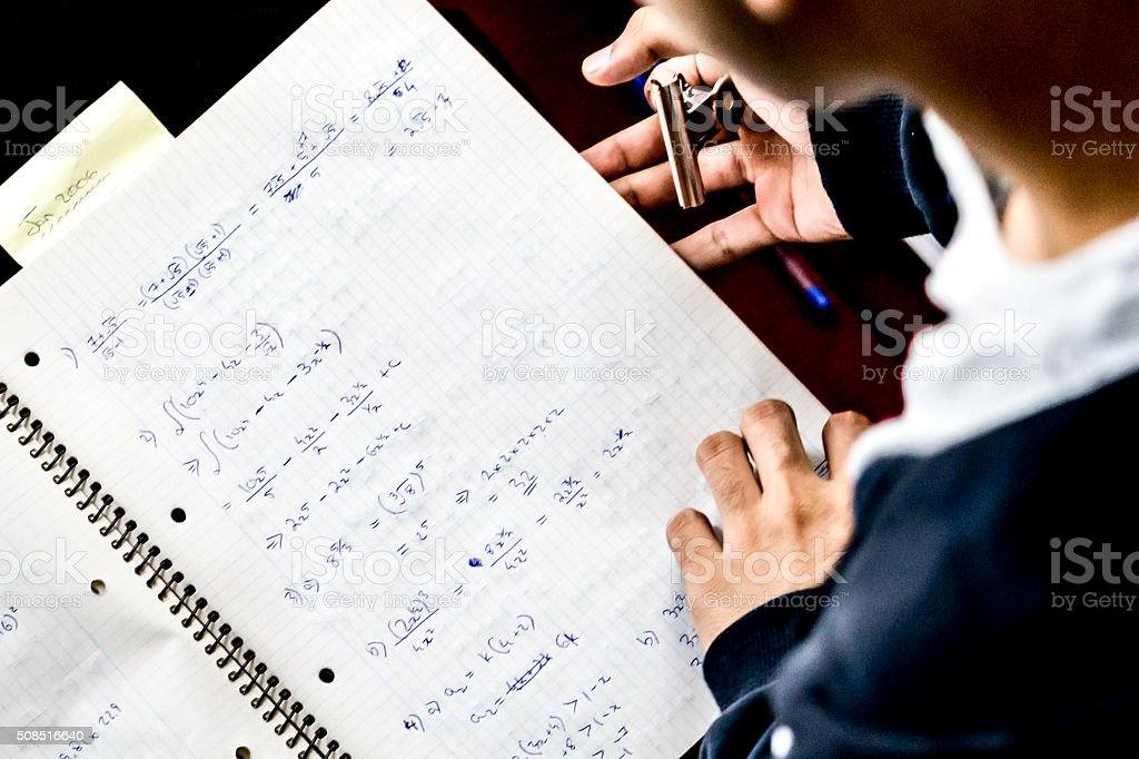 Solving Complex Mathematical Equations stock photo