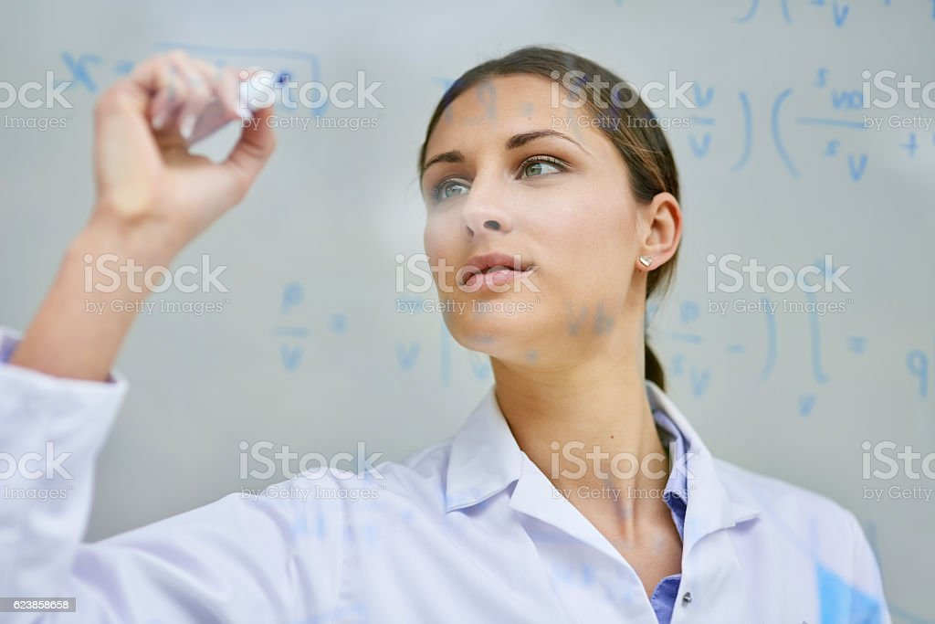 Solving equations to find all the solutions she needs stock photo