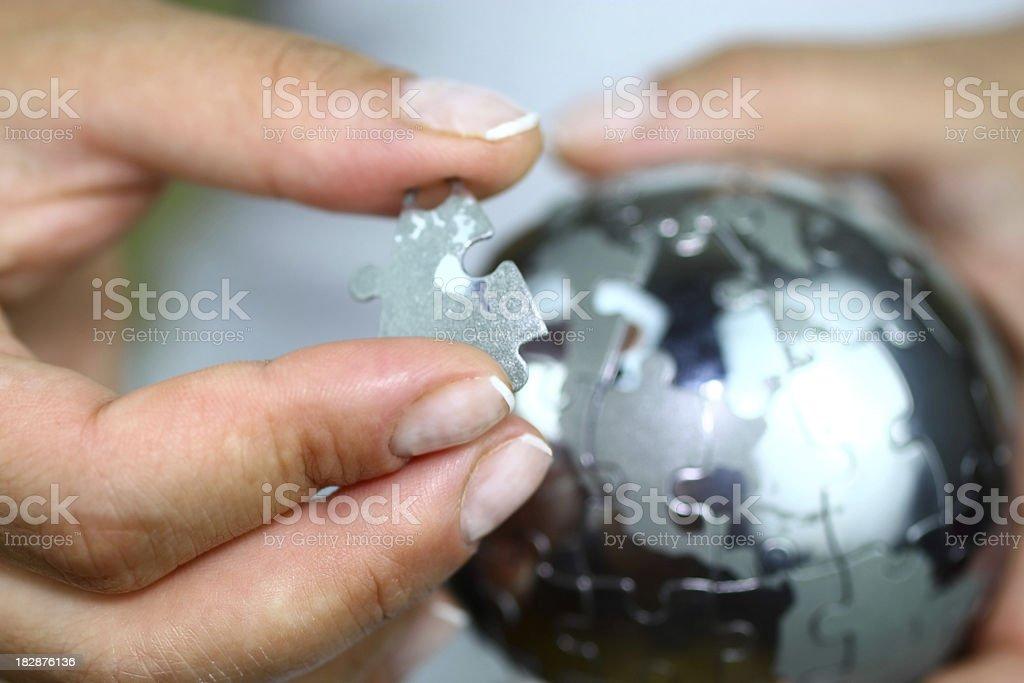 Solving globe puzzle stock photo