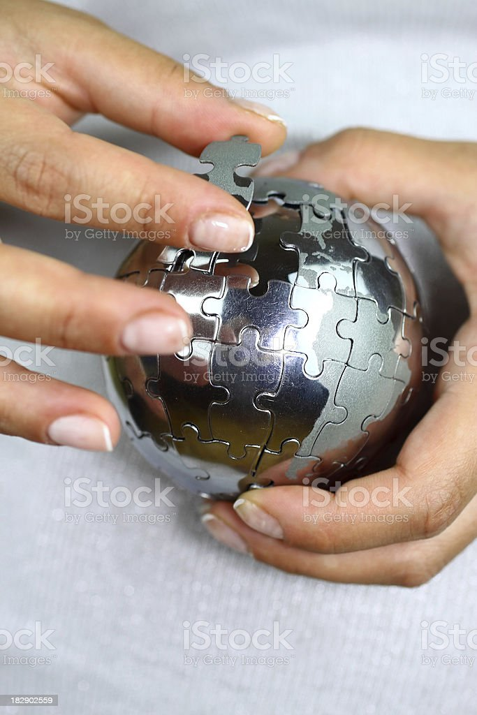 Solving globe puzzle royalty-free stock photo