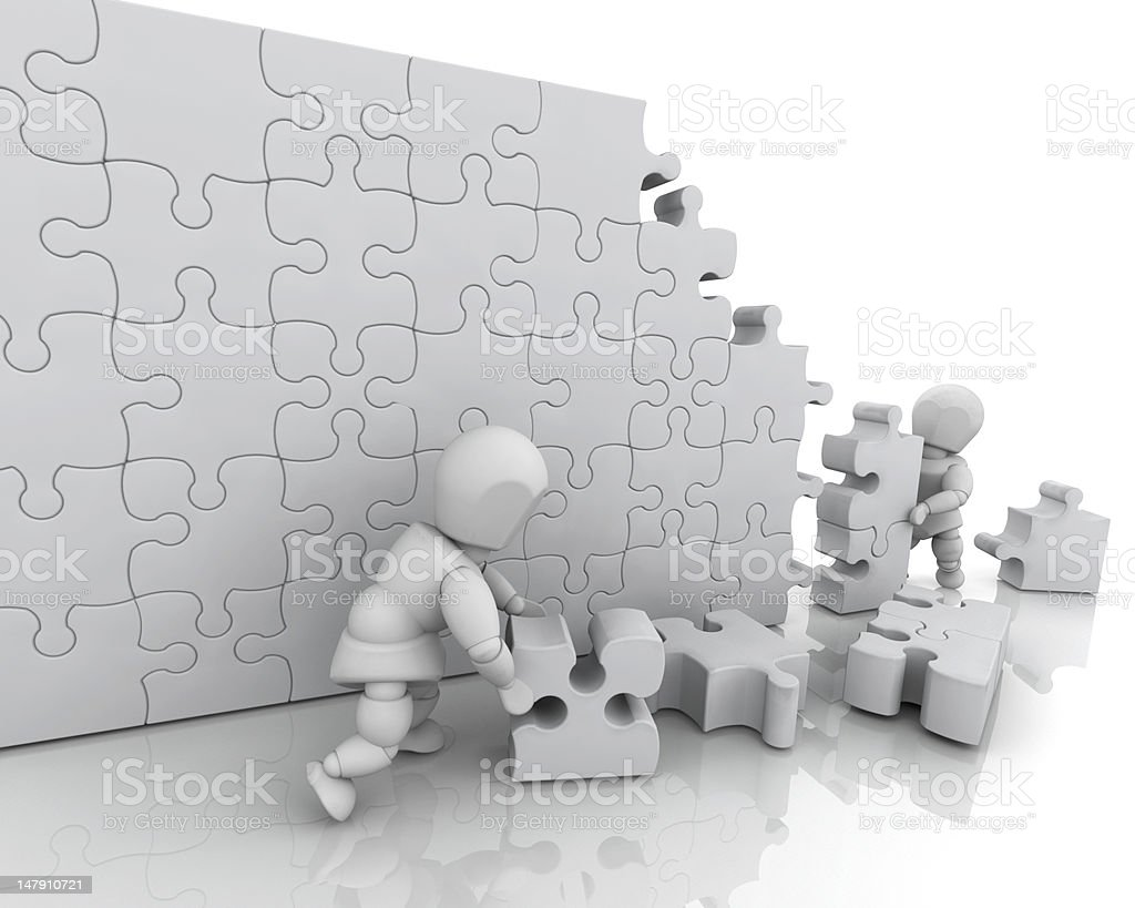 Solving jigsaw puzzle royalty-free stock photo