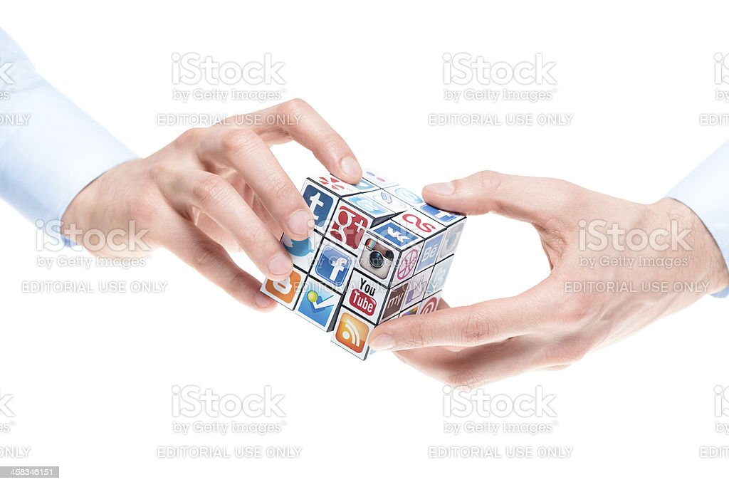 Solving Rubick's Cube with social media logos stock photo