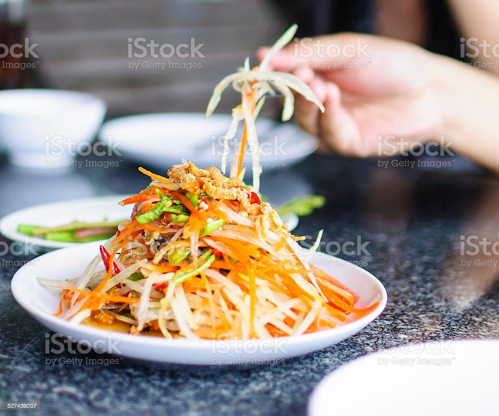 Som Tam Thai - Thai green papaya salad with peanuts. stock photo