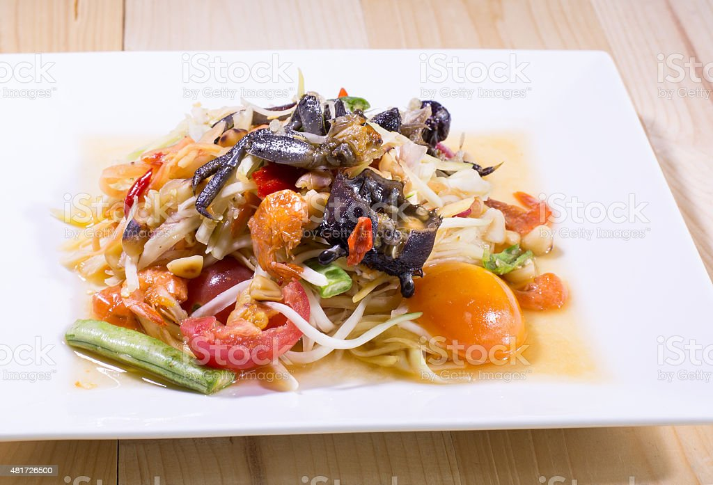 Som Tam (Spicy Papaya Salad) with salted crab, Thai food stock photo
